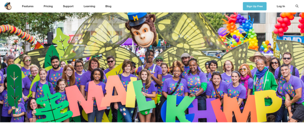 Mailchimp features their entire team in a colorful background on their about us page