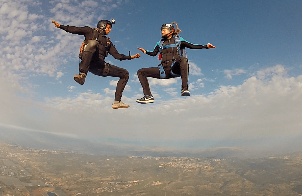 Talia Wolf skydiving with a friend